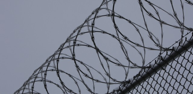 barbed wire over prison fence
