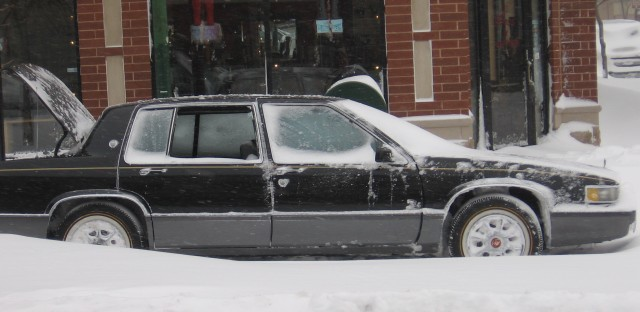 A car at Chicago and Campbell - apparently burglarized during the blizzard - 8 am.
