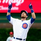 Chicago Cubs' Ben Zobrist celebrates after hitting an an RBI double during the first inning of a baseball game against the Philadelphia Phillies Saturday, May 28, 2016, in Chicago.
