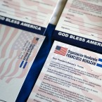 Postcards addressed to President Donald Trump asking him to extend Temporary Protected Status (TPS) for tens of thousands of Central Americans and Haitians, are shown during a news conference in Miami, Florida, Wednesday, June 7, 2017.