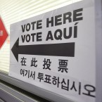 A voter enters a polling place with multilingual instructions in New York City's Chinatown in 2006. Analysts have described the Asian-American political shift as one of the most dramatic swings in recent presidential voting behavior across any demographic.