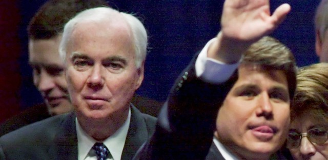 "Chicago Alderman Richard Mell, left, looks on as his son-in-law, Illinois Gov. Rod Blagojevich waves during his inauguration in Springfiled, Ill., in this Jan. 13, 2002 file photo. Mell has been on the Chicago City Council long enough to remember the days when he and his fellow aldermen could hand out city jobs and contracts like candy. But when a witness in the major corruption trial of a political fundraiser Antoin ""Tony"" Rezko testified Mell was angry he hadn't gotten any 'spoils' when his son-in-law was elected governor, Mell told reporters he didn't know what the guy was talking about. Like the governor, Mell, 69, is not accused by prosecutors of any wrongdoing in the trial going on at federal court in Chicago."