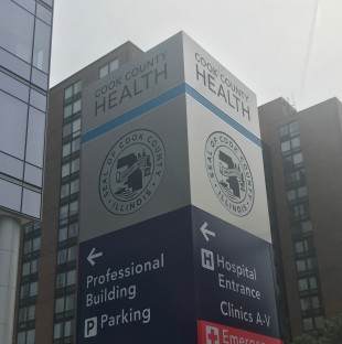 Cutline: A large sign directs Cook County Health patients around the Near West Side medical campus, which includes John H. Stroger Jr. Hospital.