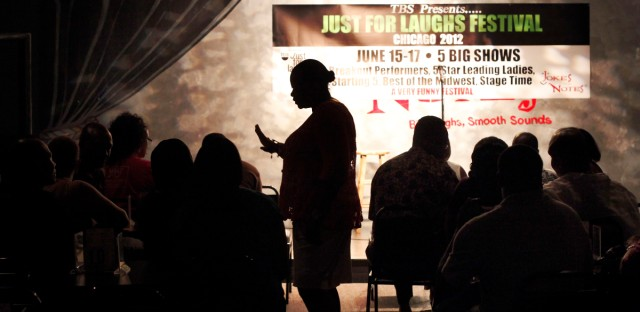 In this June 8, 2012 photo, Mary Lindsey, owner if the Jokes and Notes comedy club is silhouetted as she seats guest for the first of two shows in Chicago's Bronzeville neighborhood. African-American female club owners are a rarity in the industry of comedy, but Lindsey is breaking barriers and uplifting a community by providing a place where raw comedic talent can hone their skills.