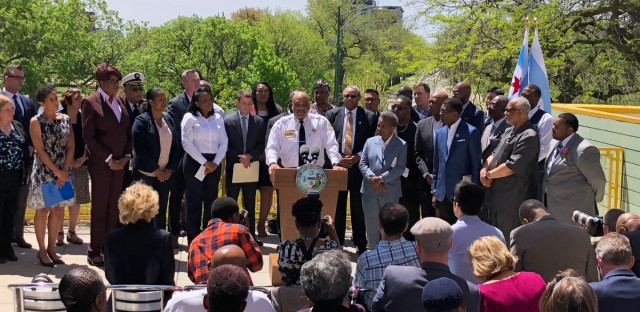 Mayor Lori Lightfoot stands to the right of Chicago Police Superintended Eddie Johnson at a Thursday press conference where she unveiled her plan to battle gun violence over the Memorial Day Weekend.