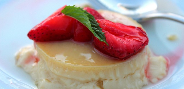 Goat's milk flan with market strawberries