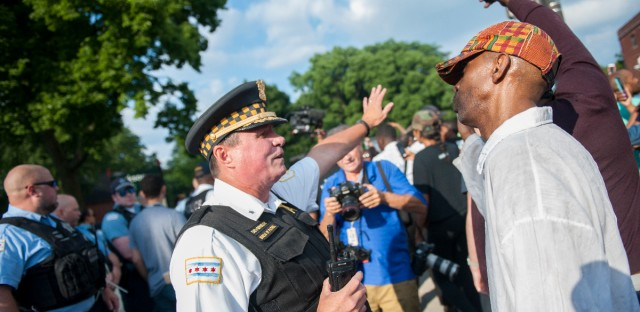 Protesters marched in the South Shore neighborhood Sunday after Chicago Police fatally shot 37-year-old Harith Augustus Saturday evening.