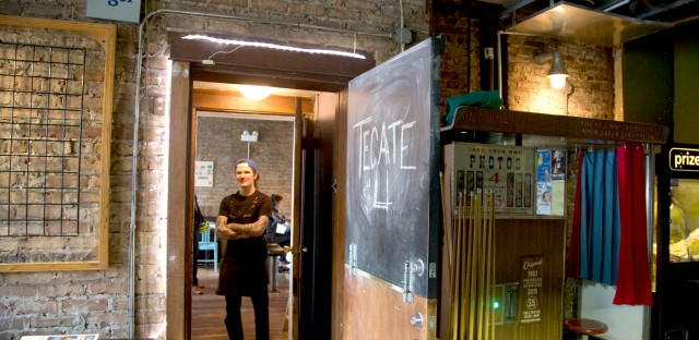 Bite Cafe chef Todd Decker inside a short hallway between the restaurant and the Empty Bottle bar and music venue. Bite's diners can bring over unopened beer and even bottles of wine from the Empty Bottle. (WBEZ/Logan Jaffe)
