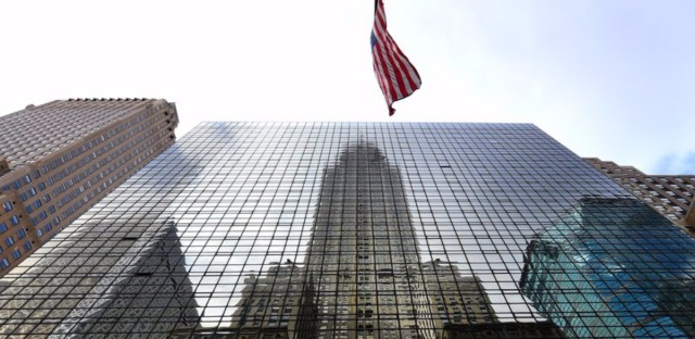 The Chrysler Building is reflected in the side of the Grand Hyatt Hotel in midtown Manhattan. The hotel on East 42nd Street was Donald Trump's first major development project. (Timothy A. Clary/AFP/Getty Images)