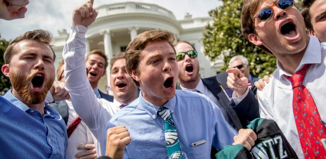 "Philadelphia Eagles fans sing the Eagles fight song during the ""Celebration of America"" event on the South Lawn of the White House, Tuesday, June 5, 2018, in Washington. President Donald Trump quickly scheduled the event with military bands after canceling a visit with the Philadelphia Eagles as he stoked fresh controversy over players who protest racial injustice by taking a knee during the national anthem."