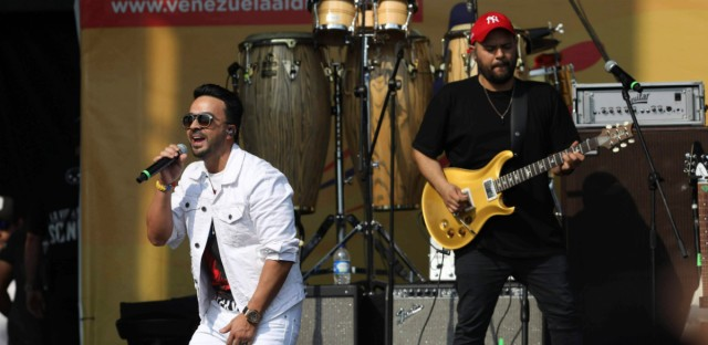 "Luis Fonsi performs at the Venezuela Aid Live concert at the Tienditas International Bridge on the outskirts of Cucuta, Colombia, Friday, Feb. 22, 2019, on the border with Venezuela. British billionaire Richard Branson organized the mega concert, which featured dozens of Latin musicians performing on a giant stage on one side of what Colombian authorities have renamed the ""Unity"" bridge."