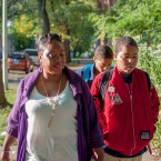 Tara Williams walks her son to school on a fall morning. Williams has spent six months fighting to get her son the special needs services she says he needs from his West Side elementary school.