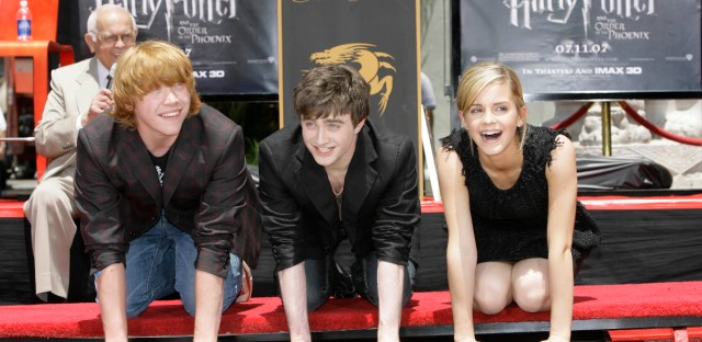 "The three stars of the ""Harry Potter"" films from left, Rupert Grint, Daniel Radcliffe, and Emma Watson place their hands and feet in cement in the forecourt of Grauman's Chinese Theatre in the Hollywood section of Los Angeles Monday, July 9, 2007."