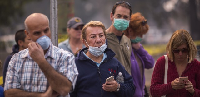 People wait in vain to be escorted to pick up possessions from their homes inside an evacuation zone in Napa on Wednesday. Many people had to flee on a moment's notice.