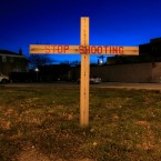 In this 2012 image, a lone cross stands in a vacant lot on the corner of 79th and Loomis in the Auburn-Gresham neighborhood on Chicago's South Side.