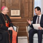 Syrian President Bashar Assad (right), speaks Monday in Damascus with Cardinal Mario Zenari, the head of the Catholic diplomatic mission in Syria. The photo was released by the Syrian official news agency SANA. The Syrian army has retaken almost all of the northern city of Aleppo, and Assad appears in a stronger position than at any point in the last several years.