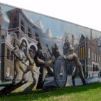 A mural representing workers at the Pullman Palace Car Company on Chicago's South Side.