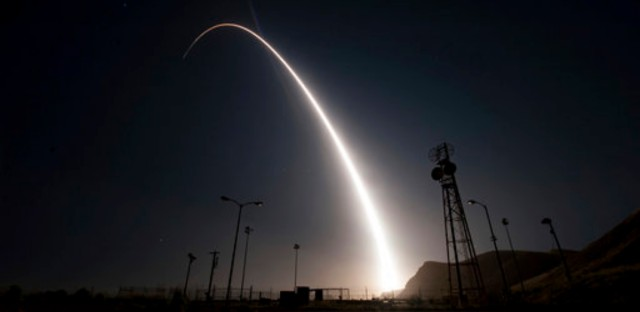 In this image taken with a slow shutter speed and provided by the U.S. Air Force, an unarmed Minuteman 3 intercontinental ballistic missile launches during an operational test early Wednesday, April 26, 201, from Vandenberg Air Force Base, Calif.