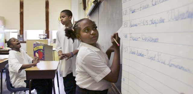 Amber Willingham copies her homework assignment from a list on the board at the Kellogg Elementary School in Chicago in 2005. Kellogg Elementary is one of the schools that would be reorganized under a plan proposed by Ald. Matt O'Shea 19th.