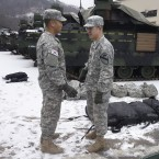 """An American soldier (right) from the First Armored """"Ironhorse"""" Brigade of the 1st Calvary Division is among those who began arriving in South Korea in mid-January. They are replacing U.S. troops that cycle out in February. He's speaking with a South Korean soldier who's part of an integrated U.S.-South Korean division."""