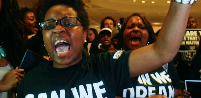 Charlene Carruthers, representing the Black Youth Project 100's in Chicago, protests outside Florida Gov. Rick Scott's office at the Capitol in Tallahassee, Fla., July 26, 2013.