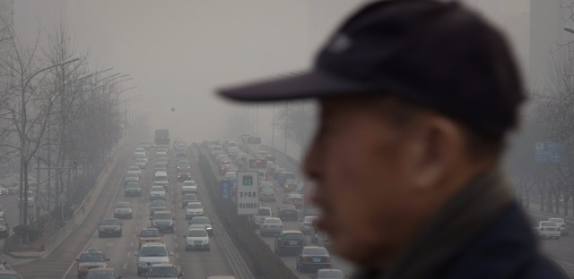 Beijing has awful traffic jams and heavy pollution. Its new subway system can only help. Ed Jones/AFP/Getty Images