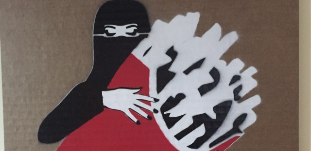 """A veiled woman and a man embrace in this work by Mohammed Labban at the recent art exhibition """"LoudArt,"""" an annual event in the Saudi Arabian city of Jeddah. The exhibit, curated by a woman, often challenges conservative traditions in the kingdom."""