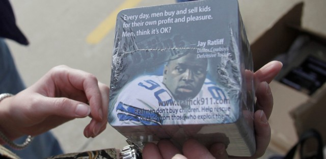 In this photo made Thursday, Jan. 27, 2011, anti-sex trade advocate Jackie Edmonds holds anti-trafficking awareness coasters that her group will ask restaurants to use near the Super Bowl site in Arlington, Texas. Cities that host the big game often attract a bustling sex trade, and this year Texas authorities and advocacy groups are stepping up their anti-prostitution efforts, especially where young girls are concerned.