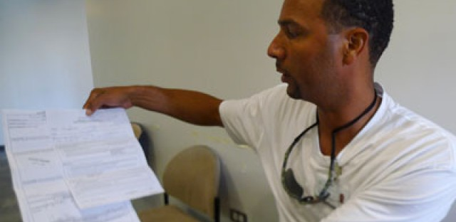 Louis Wilkins, a former inmate at Vandalia, looks over a grievance he filed about conditions there.