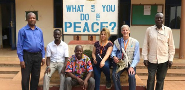 Nonviolent Peaceforce International Protection Officer John Reuwer with interfaith pastors in South Sudan