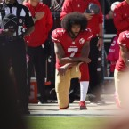 Colin Kaepernick kneels for the National Anthem before a game last October in Santa Clara, California. Ezra Shaw/Getty Images