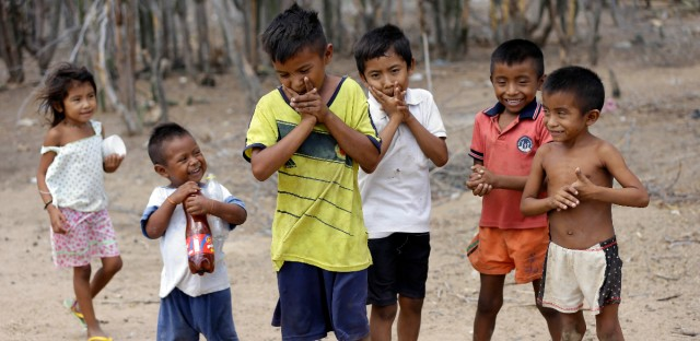 Wayuu indigenous children play in Manaure, Colombia, Thursday, Sept. 10, 2015. La Guajira peninsula has the highest malnutrition rate in Colombia, at 11 percent, according to the public defender's office.