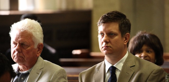 Jason Van Dyke (right) sits with his father, Owen Van Dyke, as they attend a hearing at Leighton Criminal Courts Building in August 2016.