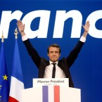 FILE - In this Sunday April 23, 2017 file photo, French centrist presidential candidate Emmanuel Macron waves before addressing his supporters at his election day headquarters in Paris. They could hardly be more different: Pro-European centrist Emmanuel Macron is facing anti-immigration, anti-EU Marine Le Pen in France's presidential runoff May 7.
