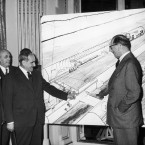 "British and French personalities met at the ""Cercle Interallie"" club in Paris, to discuss the possibilities of digging a tunnel under the Channel, between France and England. Shown here standing in front of a plan of the tunnel, are, left to right, Leo d?Erlanger (Britain) Rene Malcor (France), Louis Armand, of French railways, French ambassador to Britain, Rene Massigli and Lord Harcourt, of Britain."