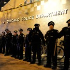 Chicago police officers line up outside the District 1 central headquarters during a protest of the police shooting of 17-year-old Laquan McDonald on Nov. 24, 2015.