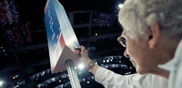 Illinois delegate Stella Kozanecki signs on the post before the start of the final day of the Republican National Convention in Cleveland, Thursday, July 21, 2016.