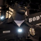 Police body cameras are seen on a mannequin at an exhibit booth by manufacturer Wolfcom at the International Association of Chiefs of Police conference in Chicago, on Oct. 26.