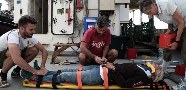 Mark Leirer (center) working on the Doctors Without Borders/Médecins Sans Frontières (MSF) search-and-rescue vessel the Aquarius in the Mediterranean Sea.