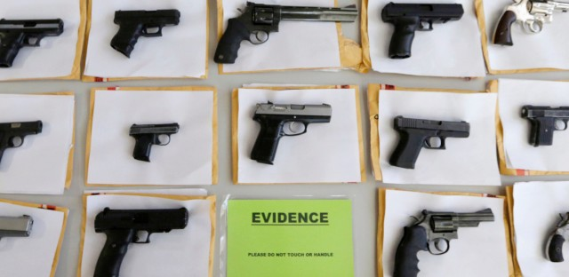 In this 2014 file photo, Chicago police display some of the thousands of illegal firearms they confiscated during the year in their battle against gun violence in Chicago. At a news conference Tuesday, March 1, 2016, Chicago police said there have been about twice as many homicides and shootings so far this year in Chicago as compared to the same period in 2015, but the number of illegal guns seized has dropped.