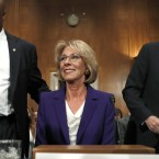 Education Secretary nominee Betsy DeVos arrives with former senator Joe Lieberman (right) and Sen. Tim Scott, R-S.C., before testifying Tuesday on Capitol Hill at her confirmation hearing.