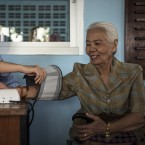 A woman has her blood pressure checked at a center for the elderly in Bangkok.