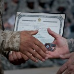 A U.S. Marine receives his Certificate of Naturalization