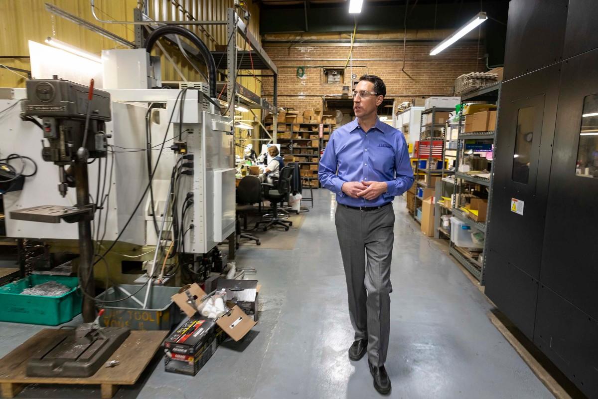 Zach Mottl walks the floor at Atlas Tool & Die Works in Lyons. The Mottl family has owned Atlas for four generations.