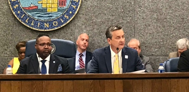Health system CEO Jay Shannon (right) addresses Cook County board members Thursday, July 25.
