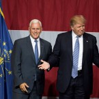 Presumptive Republican presidential candidate Donald Trump, right, and Indiana Governor Mike Pence take the stage during a campaign rally at Grant Park Event Center in Westfield, Indiana.