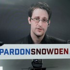 Edward Snowden speaks in September via video link from Moscow during a news conference with Human Rights Watch to call upon President Barack Obama to pardon Snowden before leaving office.