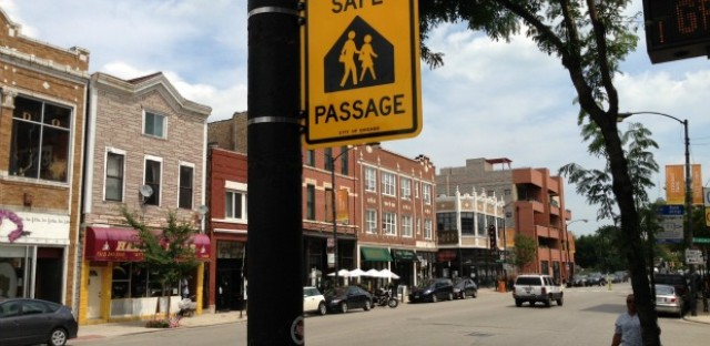 A sign, one of 1,600 the city has installed in recent weeks, marks a safe passage route along Chicago Avenue.