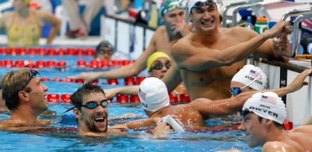 Michael Phelps, second from left, shares a laugh with other U.S. swimming team members during a training session at the Aquatics Center at the Olympic Park Monday.