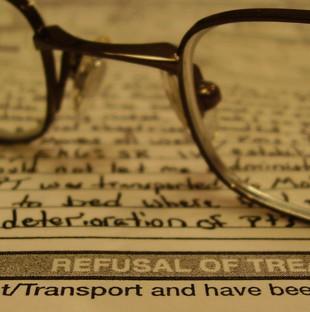 glasses lying a refusal of treatment document